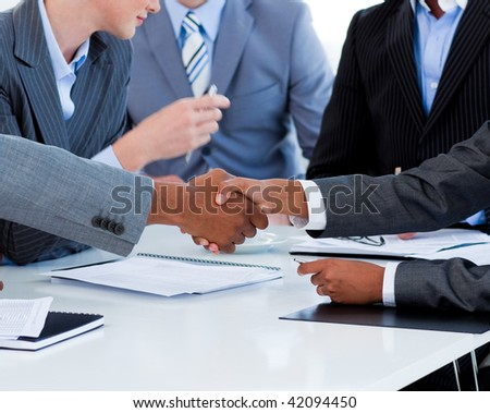 Close-up of business people greeting each other in a meeting - stock photo