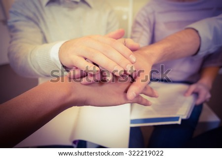 Close-up of business people with hand stack in meeting at creative office - stock photo