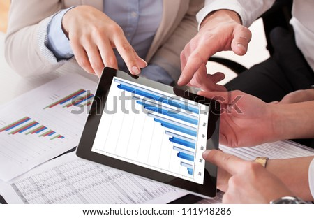 Close Up Of Business People Working Together In Office - stock photo