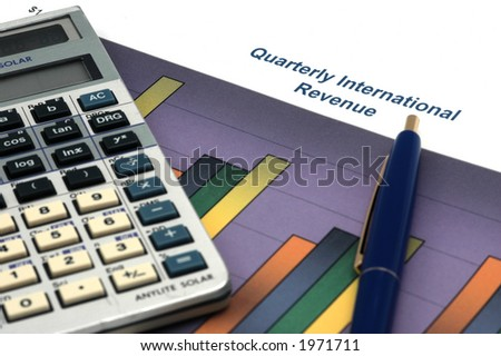 Close up of Business Report with Calculator and Pen - stock photo