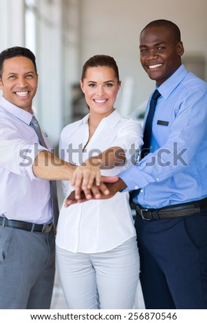 close up of business team putting their hands together - stock photo