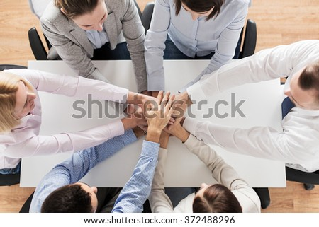close up of business team with hands on top - stock photo
