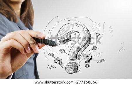 Close up of business woman drawing question mark - stock photo