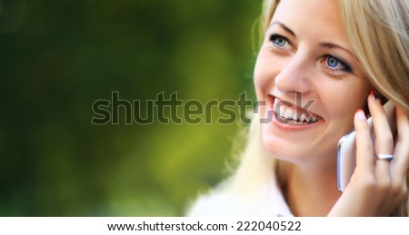 Close up of business woman on the phone - stock photo