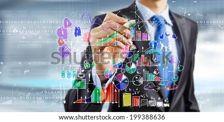 Close up of businessman drawing business sketches with marker - stock photo