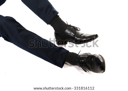 Close-up of businessman feet in black boots. - stock photo