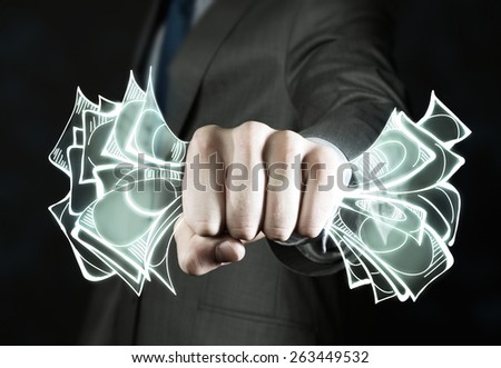 Close up of businessman grasping dollar banknotes in fist - stock photo