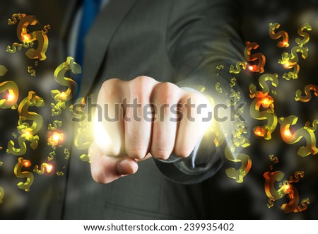 Close up of businessman grasping dollar signs in fist - stock photo