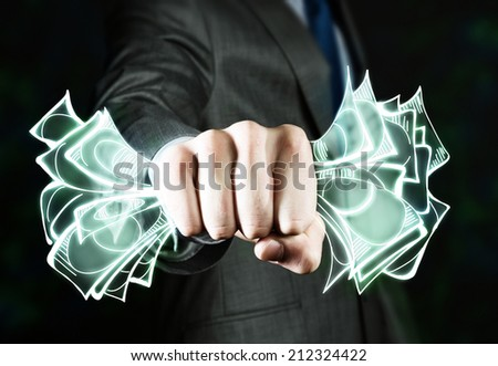 Close up of businessman hand clenching money banknotes in fist - stock photo