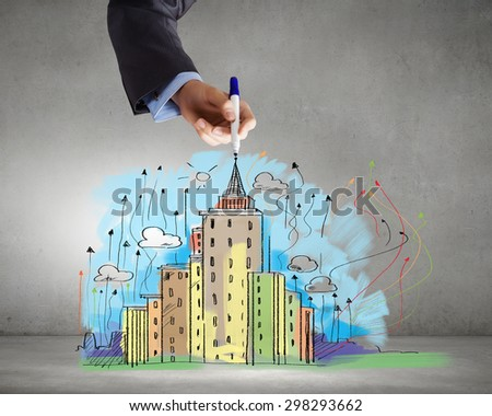 Close up of businessman hand drawing sketches of buildings - stock photo