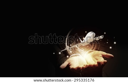 Close up of businessman hand holding airplane in palm