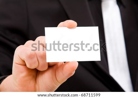 Close up of businessman hand offering businesscard