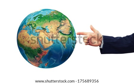 Close up of businessman hand pointing on Earth planet .