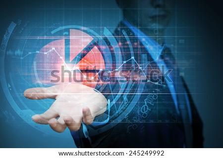 Close up of businessman hand presenting digital market graphs - stock photo