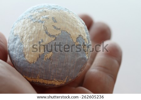 close up of businessman hand showing texture the world concept Elements of this image furnished by NASA - stock photo