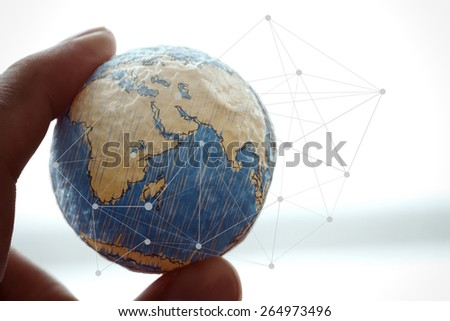 close up of businessman hand showing texture the world with digital social media network diagram concept Elements of this image furnished by NASA - stock photo