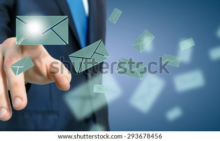 Close up of businessman hand touching icon on screen