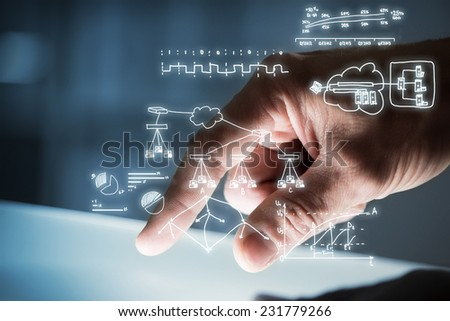 Close up of businessman hand touching tablet screen - stock photo