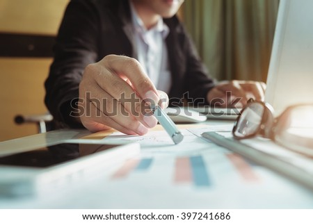 close up of businessman hand working with new modern computer and graph business with social network diagram and man working  - stock photo