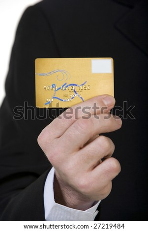 Close up of businessman holding credit card