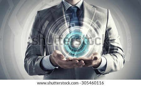 Close up of businessman holding media concept in palms - stock photo