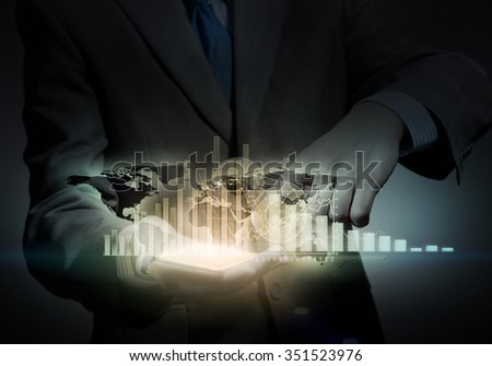 Close up of businessman holding virtual graph in palm