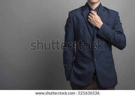 Close up of businessman in blue suit Wearing a necktie on gray background