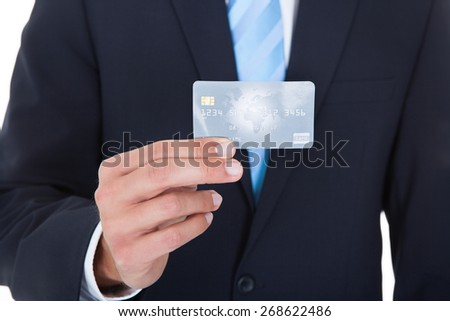 Close-up Of Businessman In Suit Holding Credit Card - stock photo