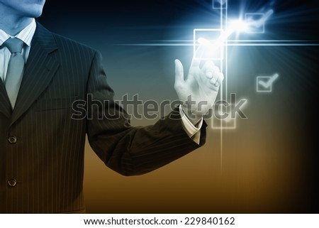 Close up of businessman pushing icon of media screen - stock photo