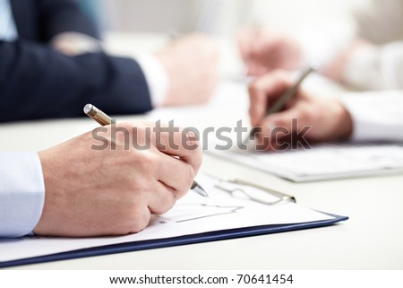 close-up of businessman?s hand writing