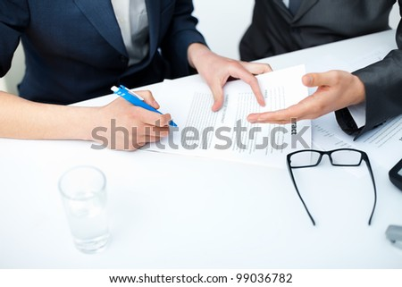 Close up of businessman's hands signing a contract - stock photo