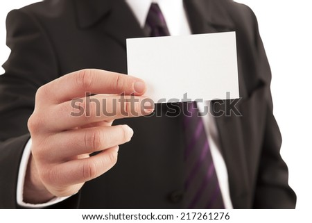 Close-up of businessman showing blank visiting card on white background