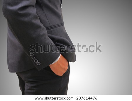 Close up of businessman standing with his hands in the pockets.  - stock photo