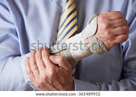 Close Up Of Businessman Suffering With Repetitive Strain Injury (RSI) - stock photo