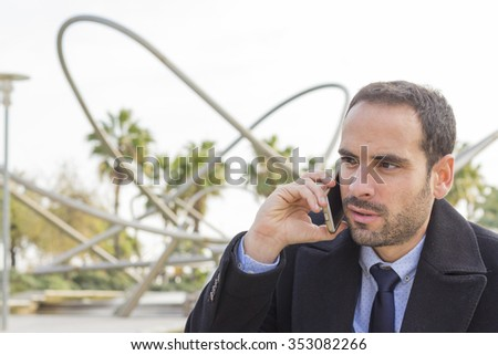 Close up of businessman talking on the smart phone - stock photo