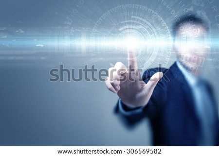 Close up of businessman touching virtual panel with finger - stock photo