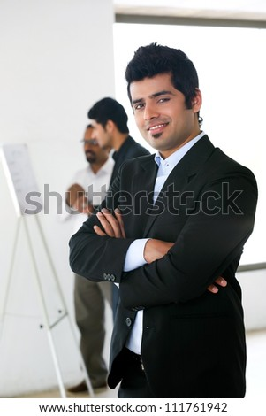 close up of businessman with colleagues in background - stock photo