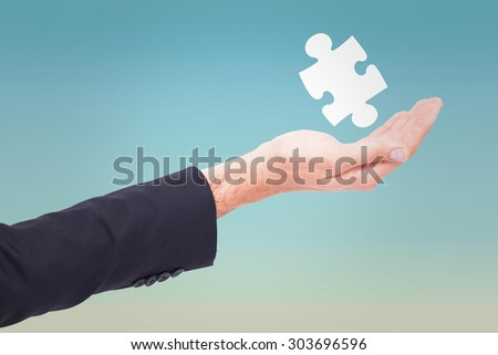 Close up of businessman with empty hand open against blue sky
