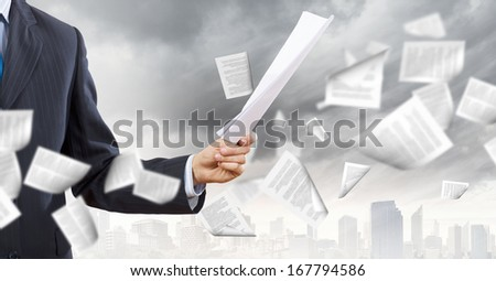 Close up of businessman with papers in hands - stock photo