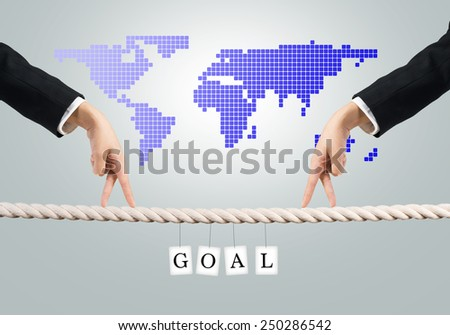 Close up of businessmen hands walking with fingers on rope - stock photo
