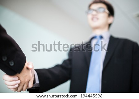 Close up of businessmen shaking hands