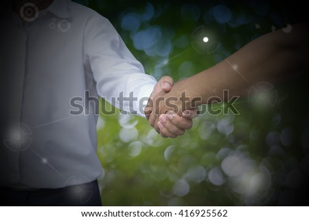 Close up of businessmen shaking hands on blurred background., finishing up a meeting.