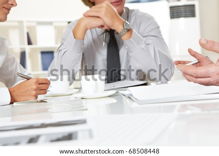 Close-up of businesspeople discussing plan at meeting - stock photo