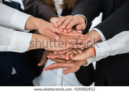 Close-up Of Businesspeople Hands Stacking Together Over Each Other