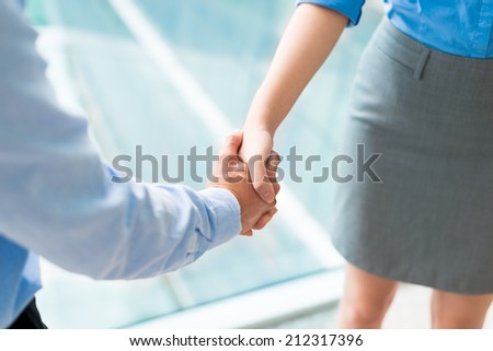 Close-up of businesspeople shaking hands - stock photo
