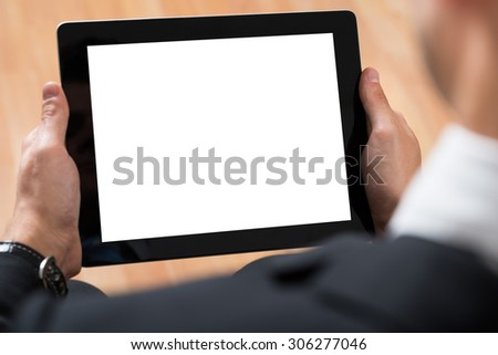 Close-up Of Businessperson Using Digital Tablet With Blank Display - stock photo