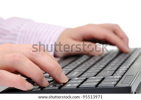 Close-up of businesswoman fingers typing a business document - stock photo