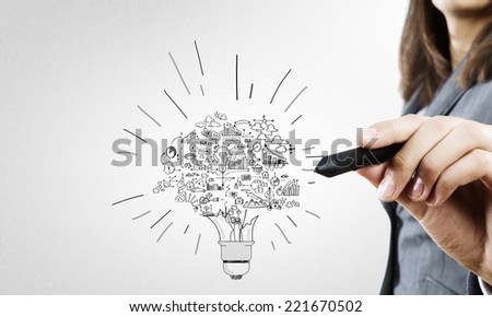 Close up of businesswoman hand drawing business strategy sketches - stock photo