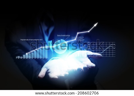 Close up of businesswoman hand presenting digital charts - stock photo