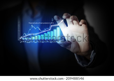 Close up of businesswoman hand presenting digital charts